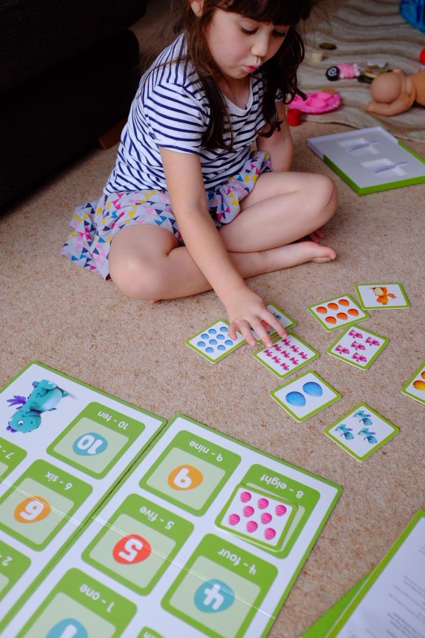 girl playing curious dragons maths game