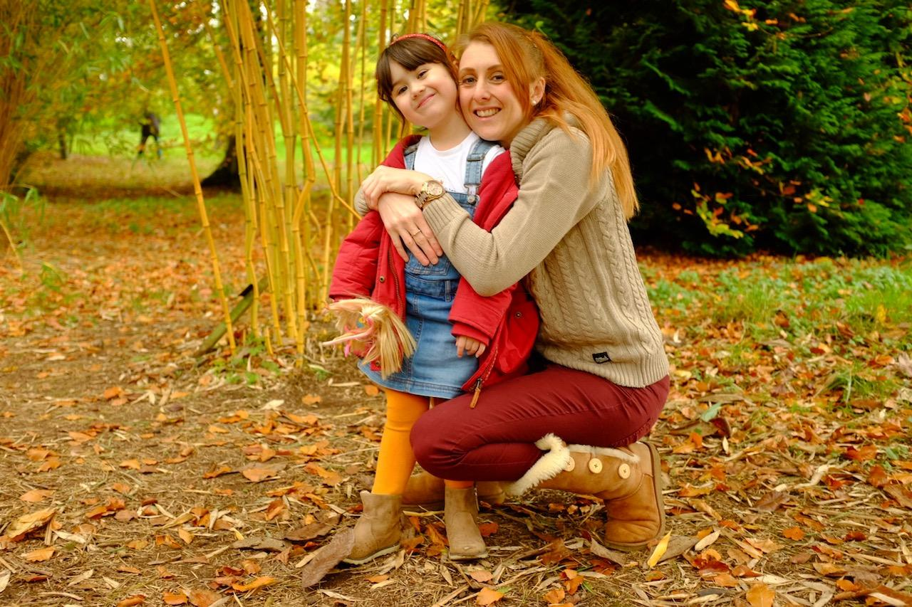 Mum hugging her daughter. Saltrock knitwear