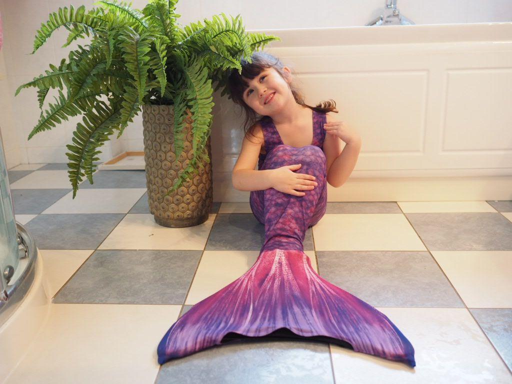 girl in purple mermaid purple tail