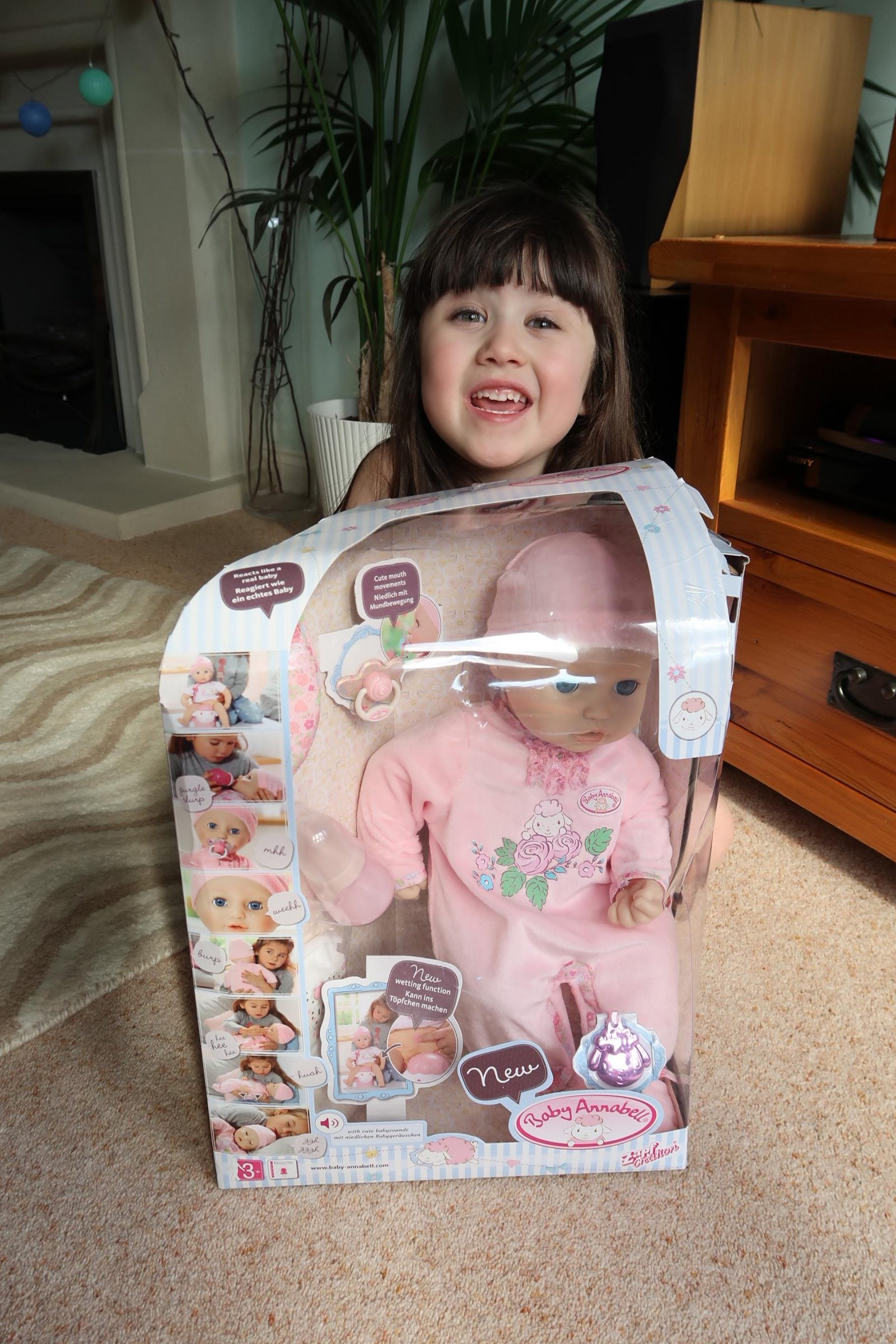 girl excited over interactive baby Annabell dol