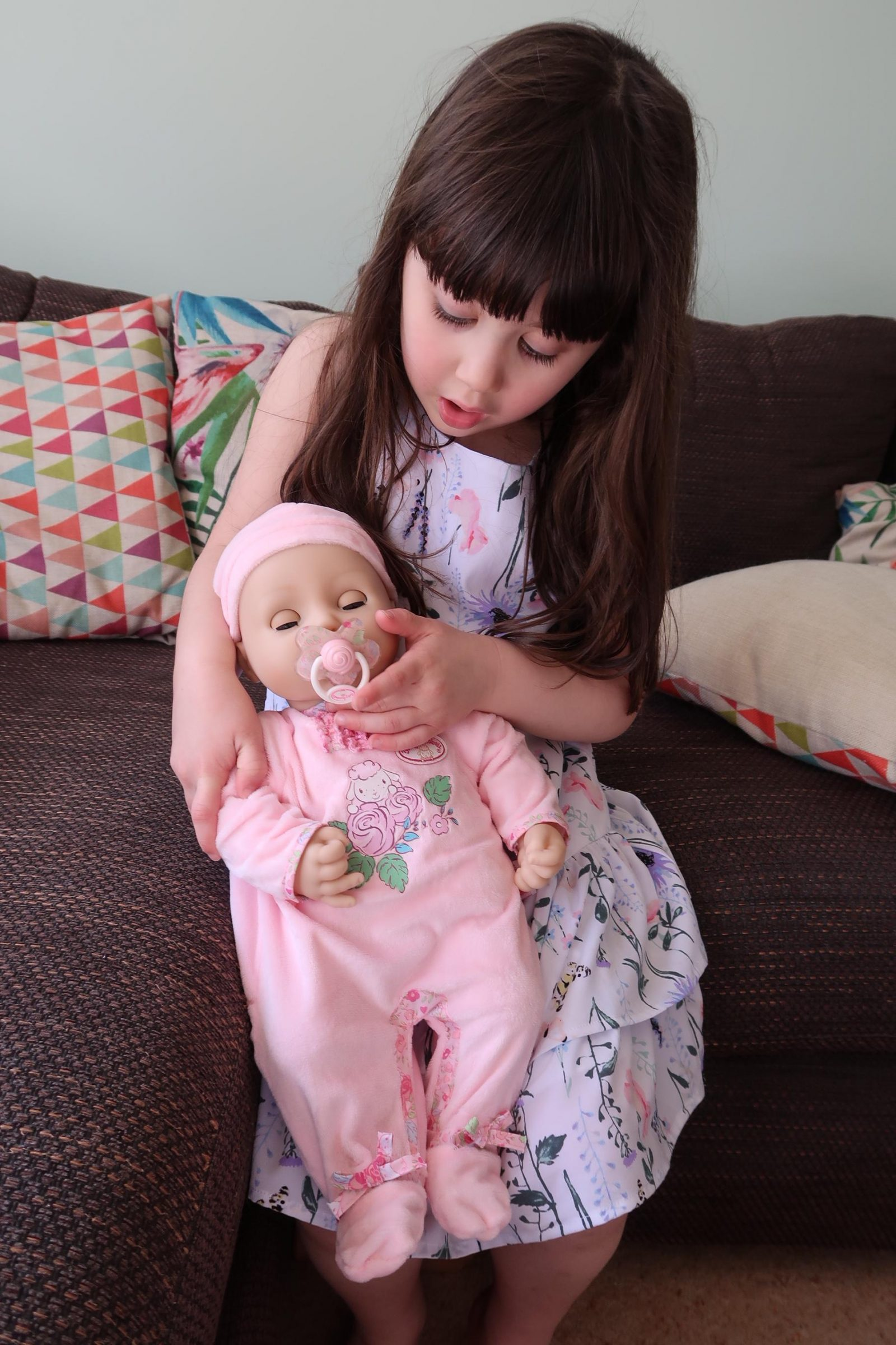 girl holding interactive baby Annabell doll
