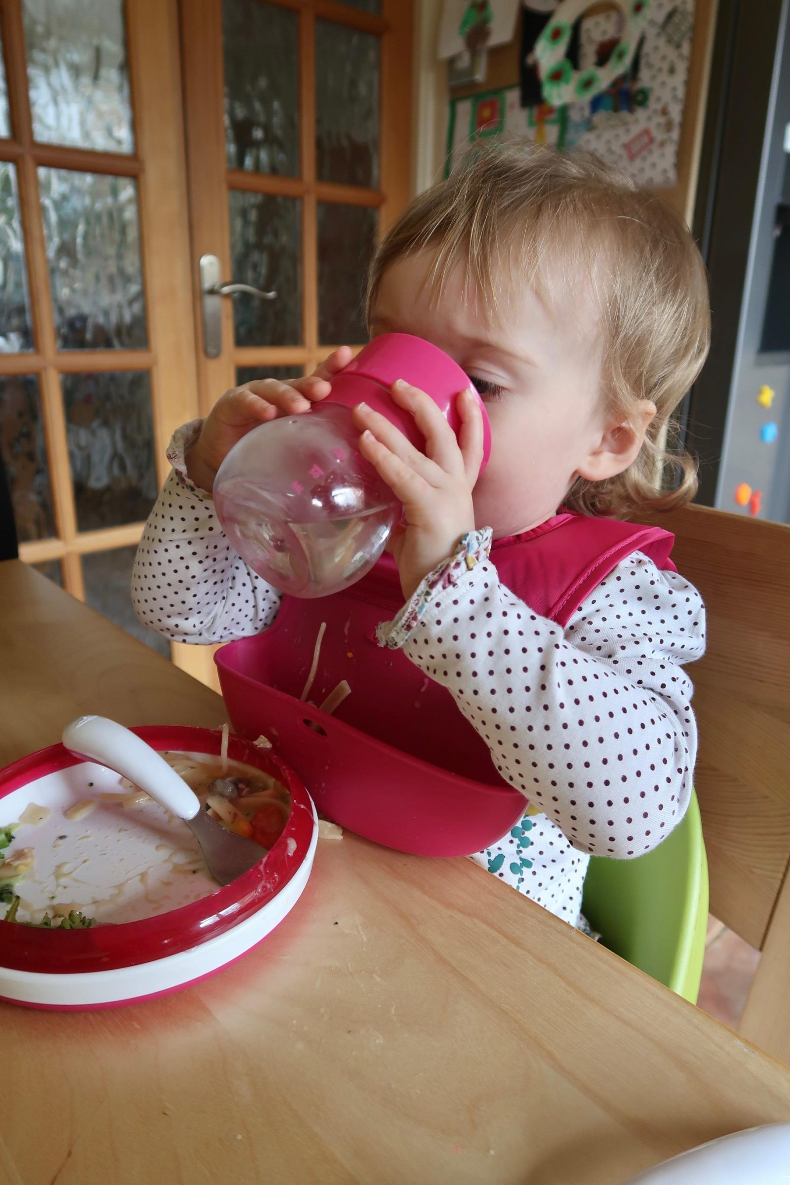 baby drinking from a oxo tot cup