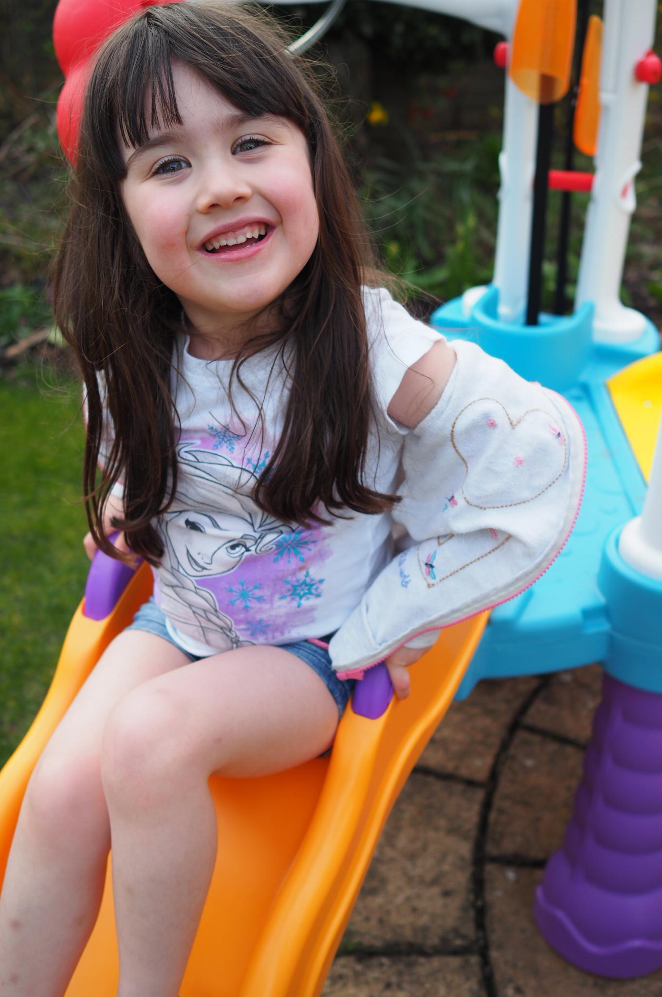 girl on slide on Little Tikes Tumblin' Tower