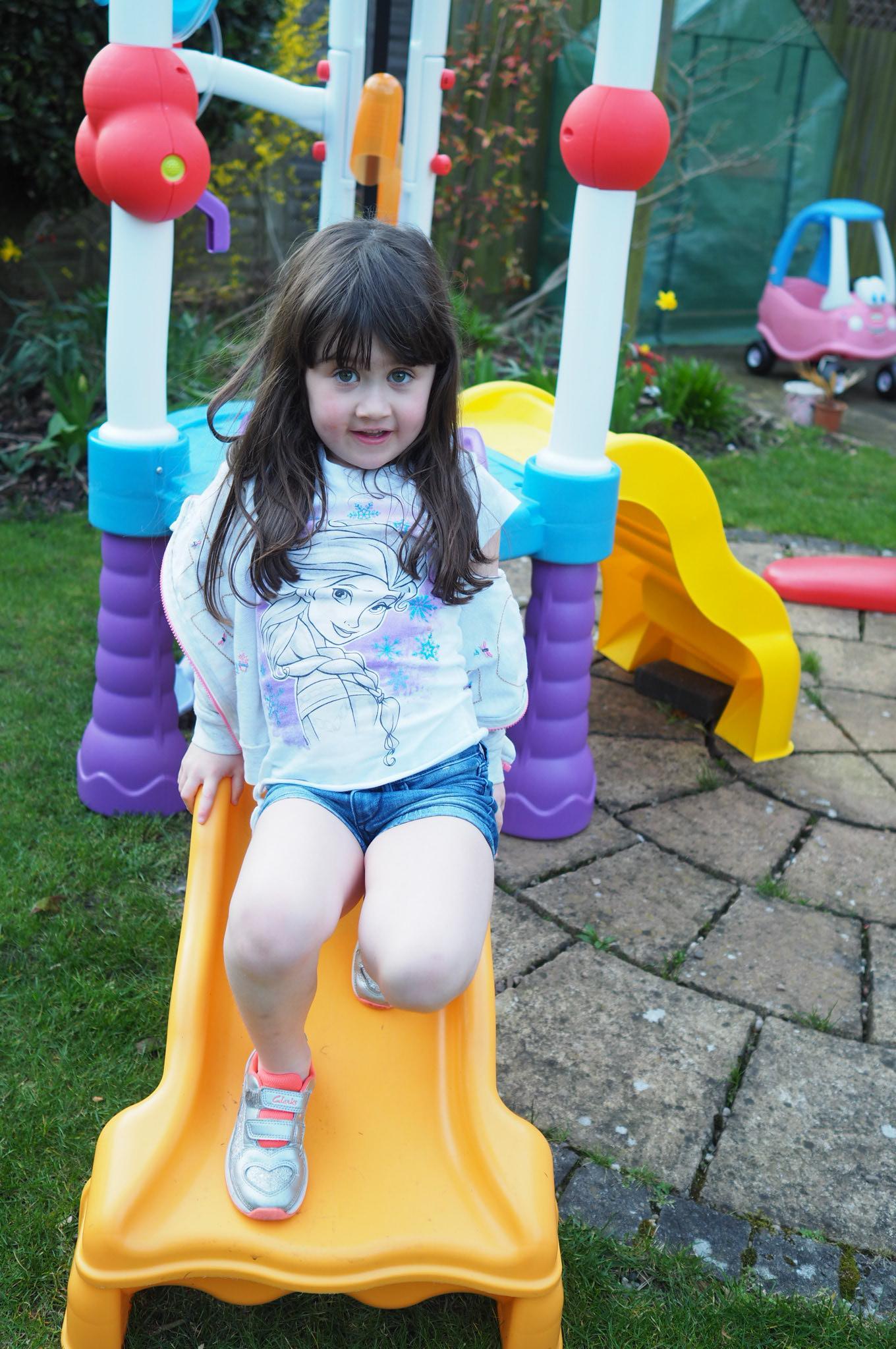 girl on slide Little Tikes Tumblin' Tower
