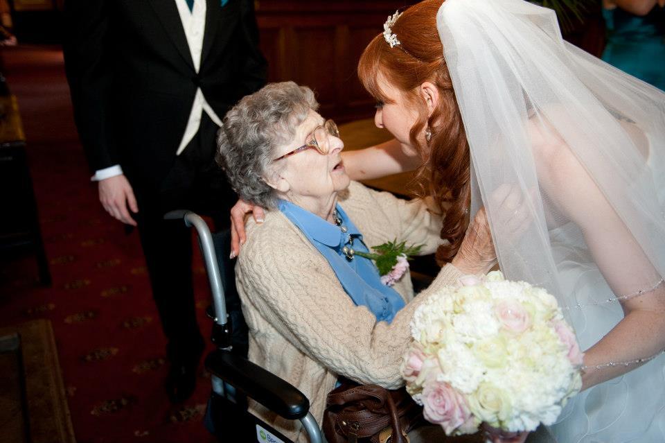 grandparent kissing her grand daughter