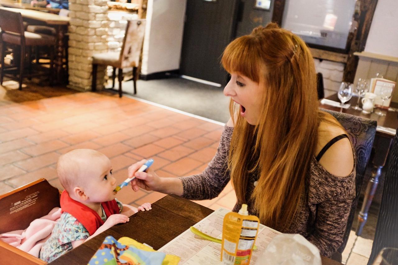 redhead Mum feeding her baby