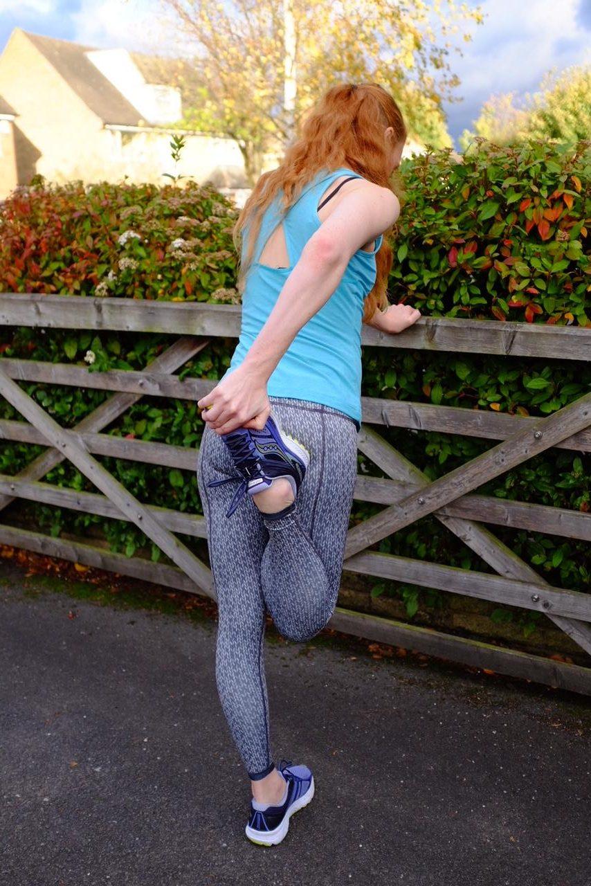 redhead stretching in gym gear