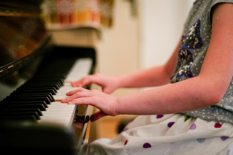 girl playing a piano