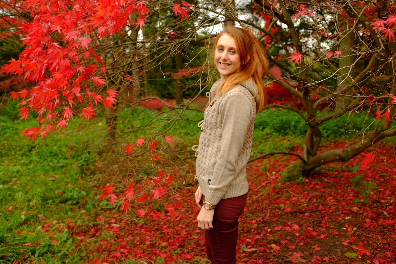 Autumnal shot of a red head in saltrock knitwear