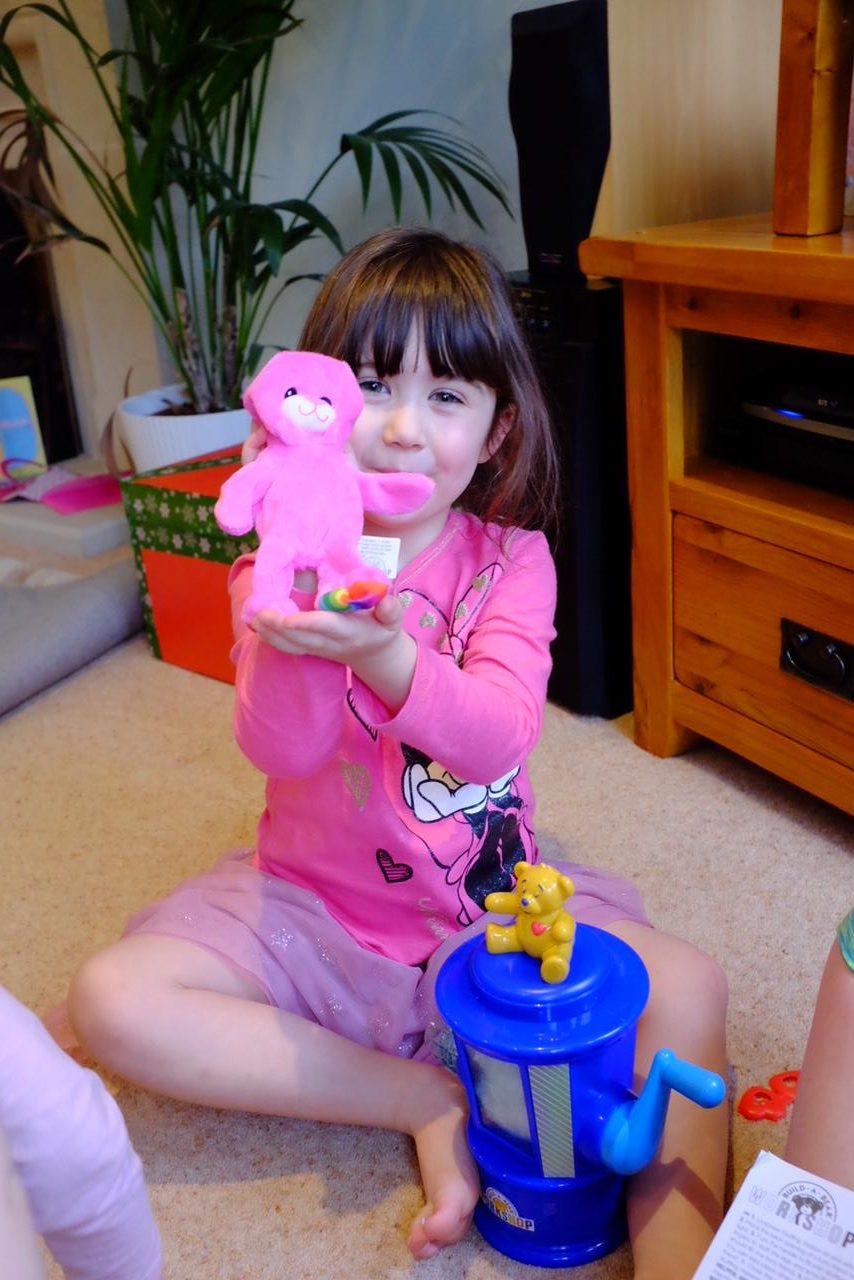 girl holding a pre-stuffed build a bear