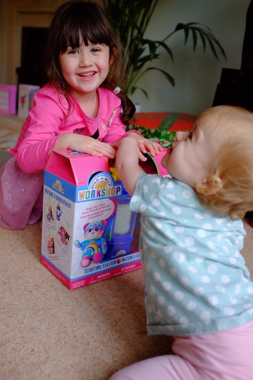 two girls will build a bear stuffing station workshop