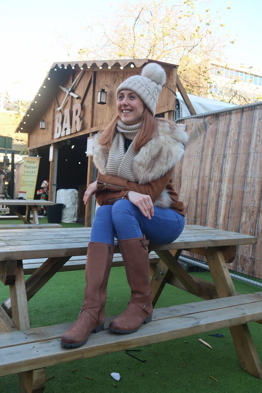 girl sat in solihull christmas market wearing hotter belle boots