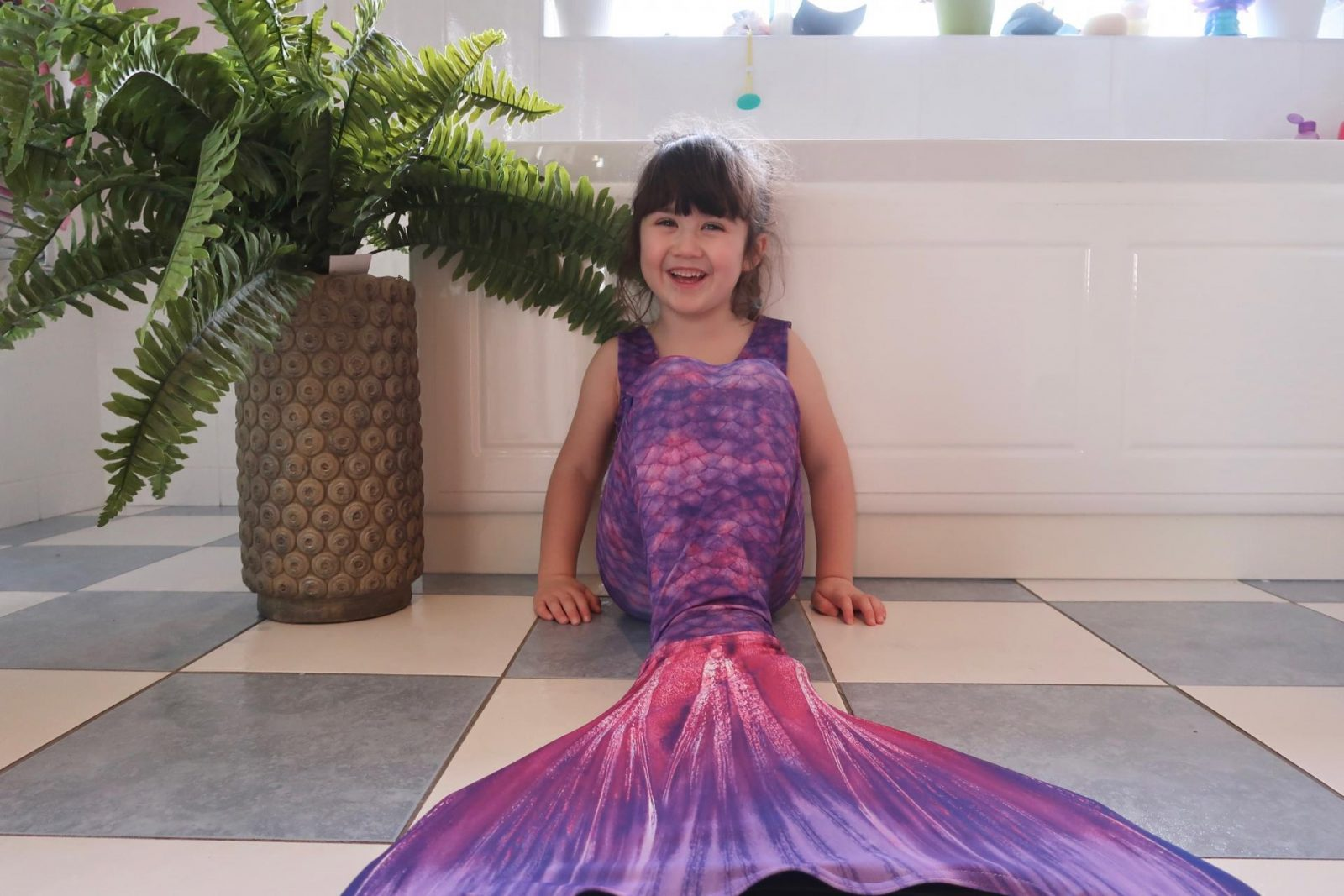girl in planet mermaid purple tail