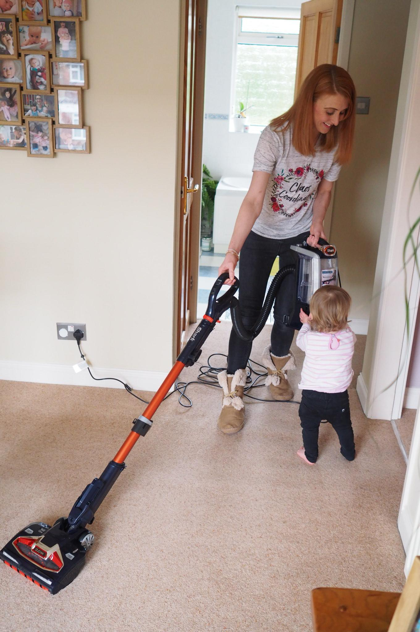 mum hoovering with a Shark hoover