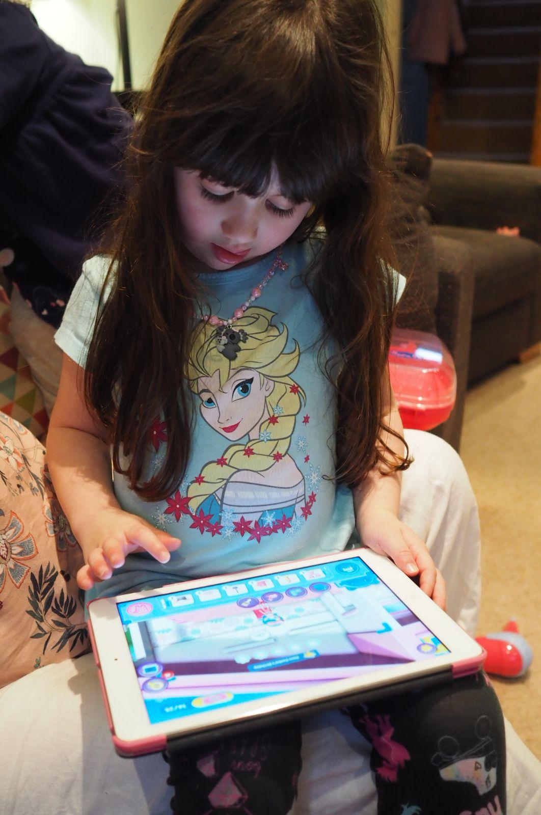 child playing shopkins happy places app