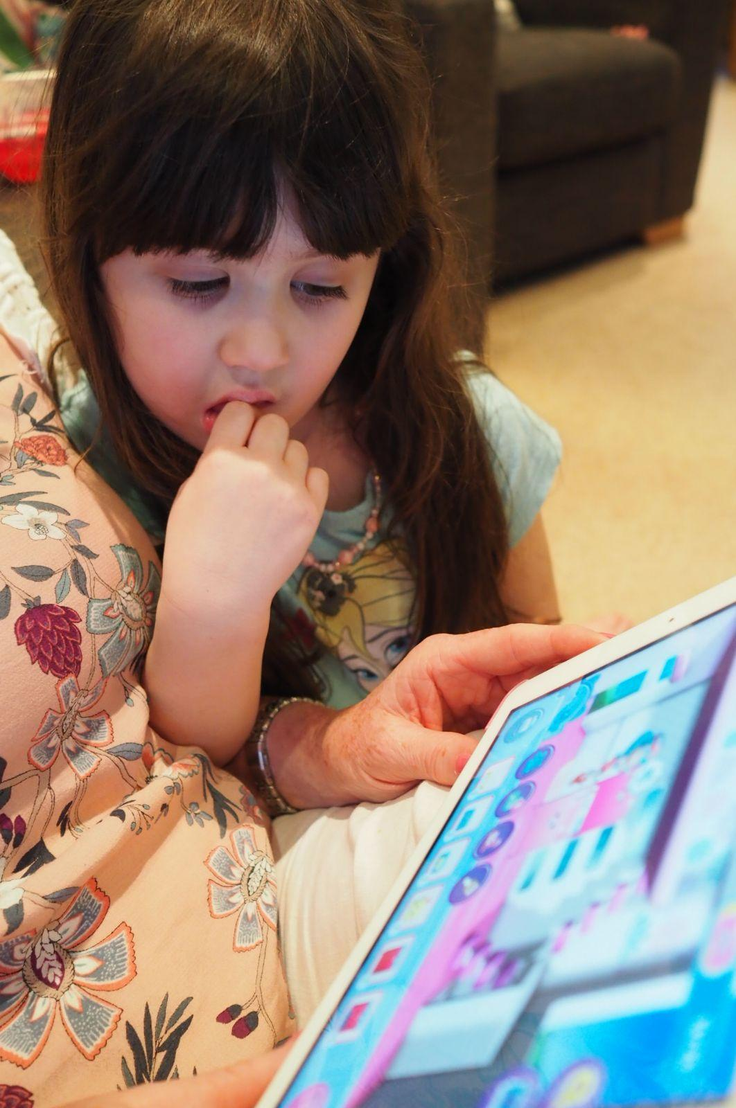 child playing on shopkins happy places app