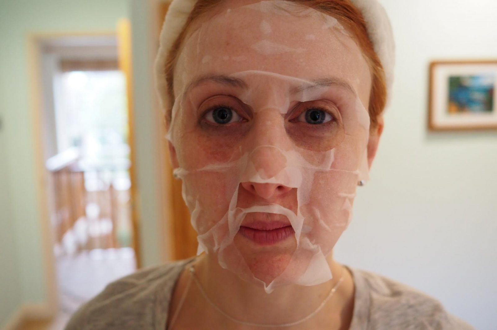redhead wearing a biocell facial masks