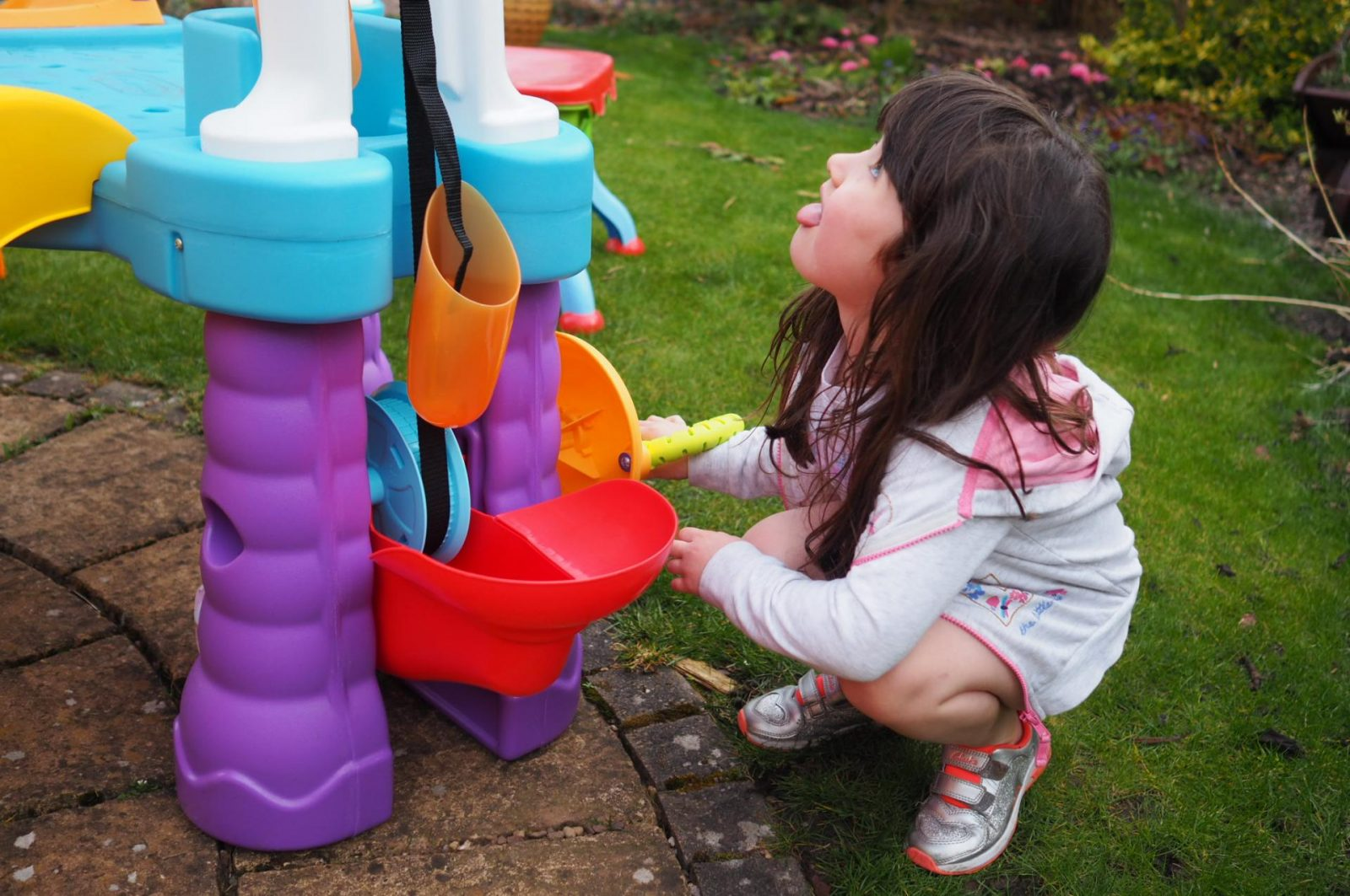 girl using conveyor belt on Little Tikes Tumblin' Tower