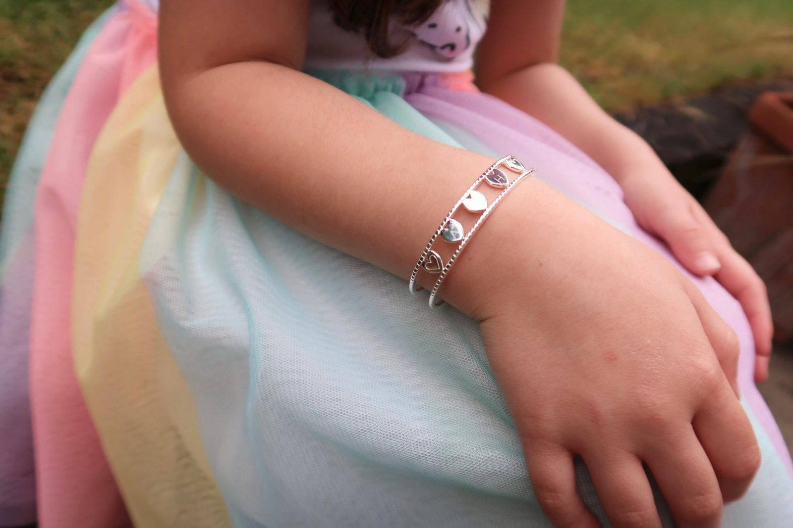 Girl wearing Molly Brown Her love bangle