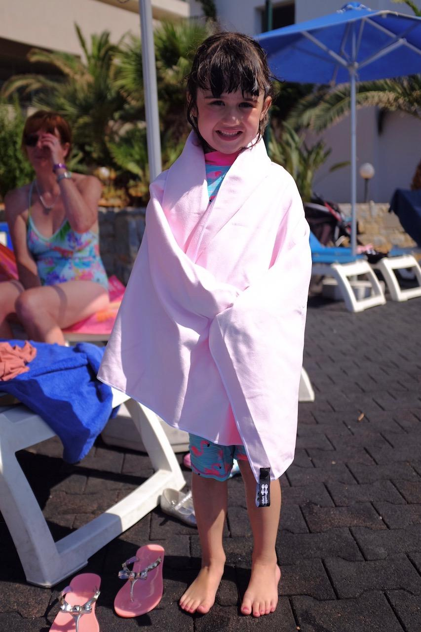 girl with a tiddlers and nippers travel towel on