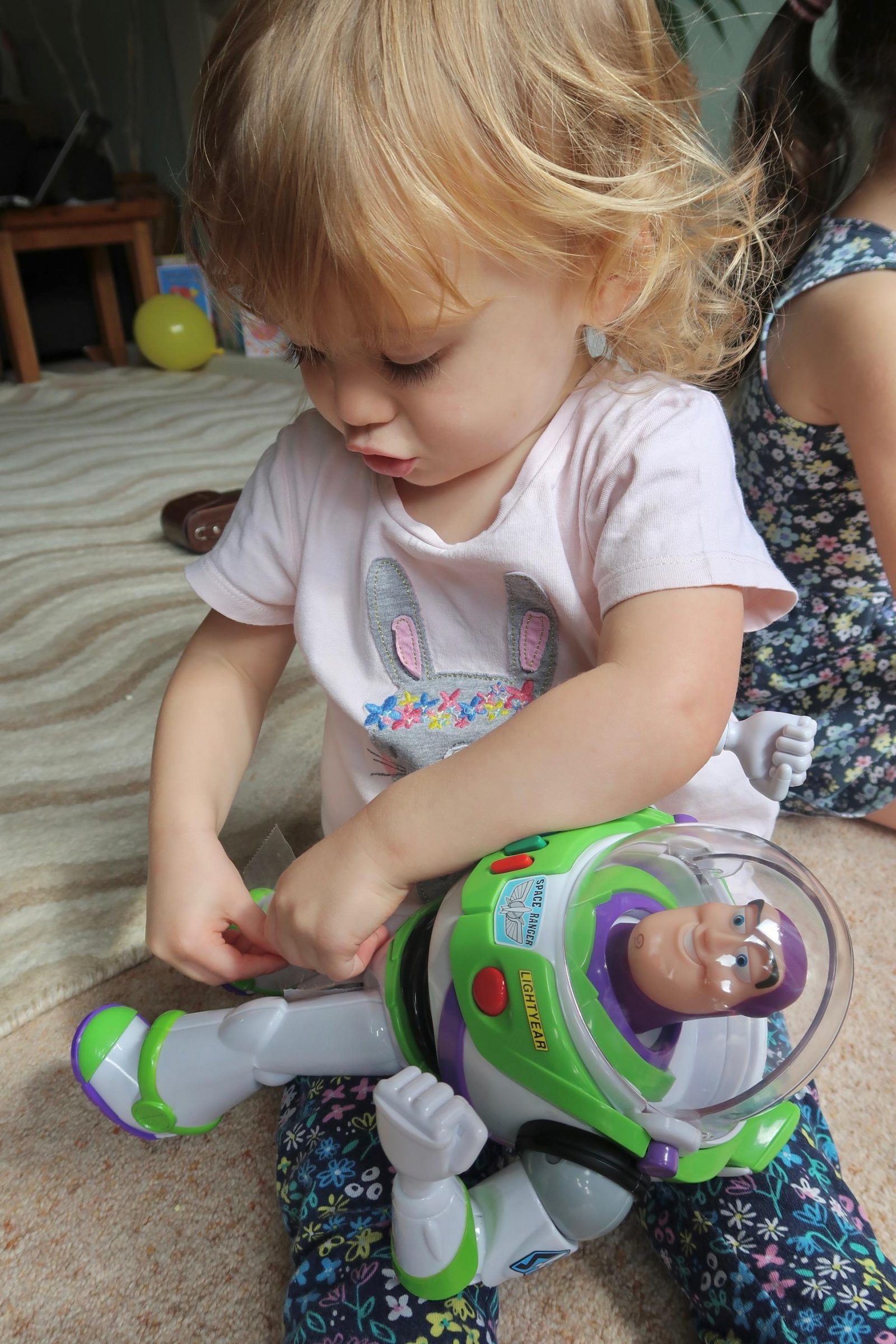 girl playing with smyths toys buzz