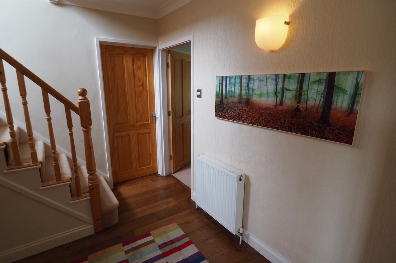 entrance hall with a poster from posterlounge