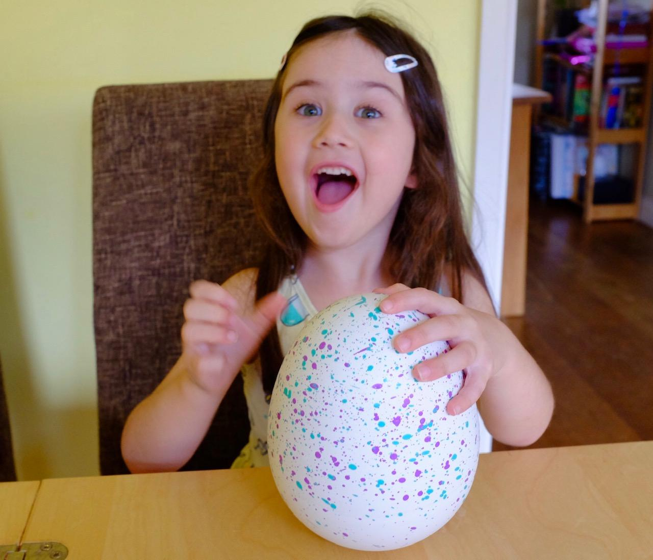 Excited girl tapping Hatchimals HatchiBabies unhatched egg