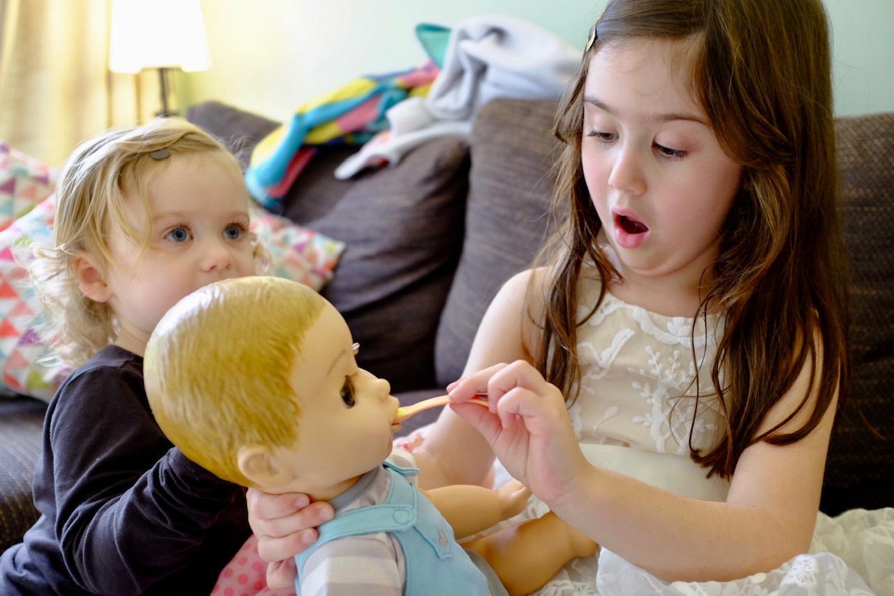 girl feeding Luvabeau doll Luvabella