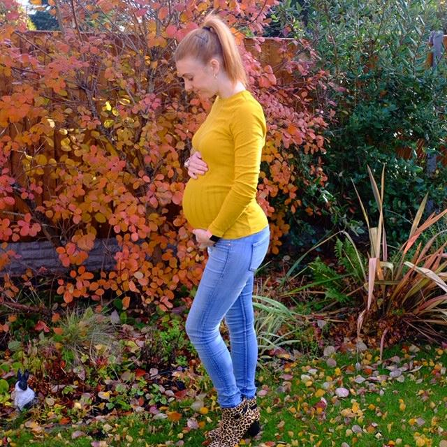 pregnant lady in an autumn garden