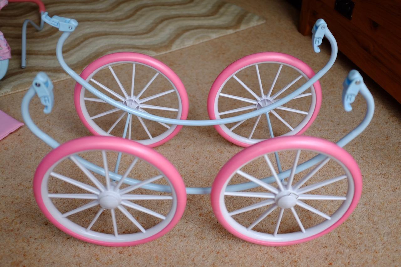 wheel attached to base of Baby Annabell Carriage pram
