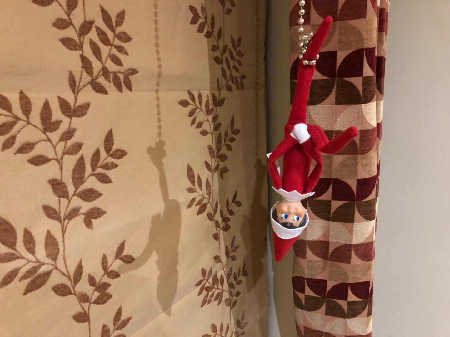 elf on the shelf hanging upside down