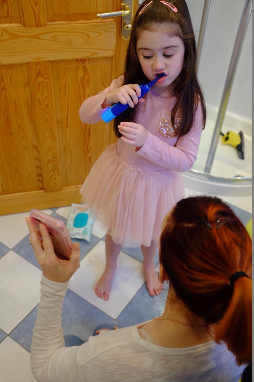 Girl using Playbrush