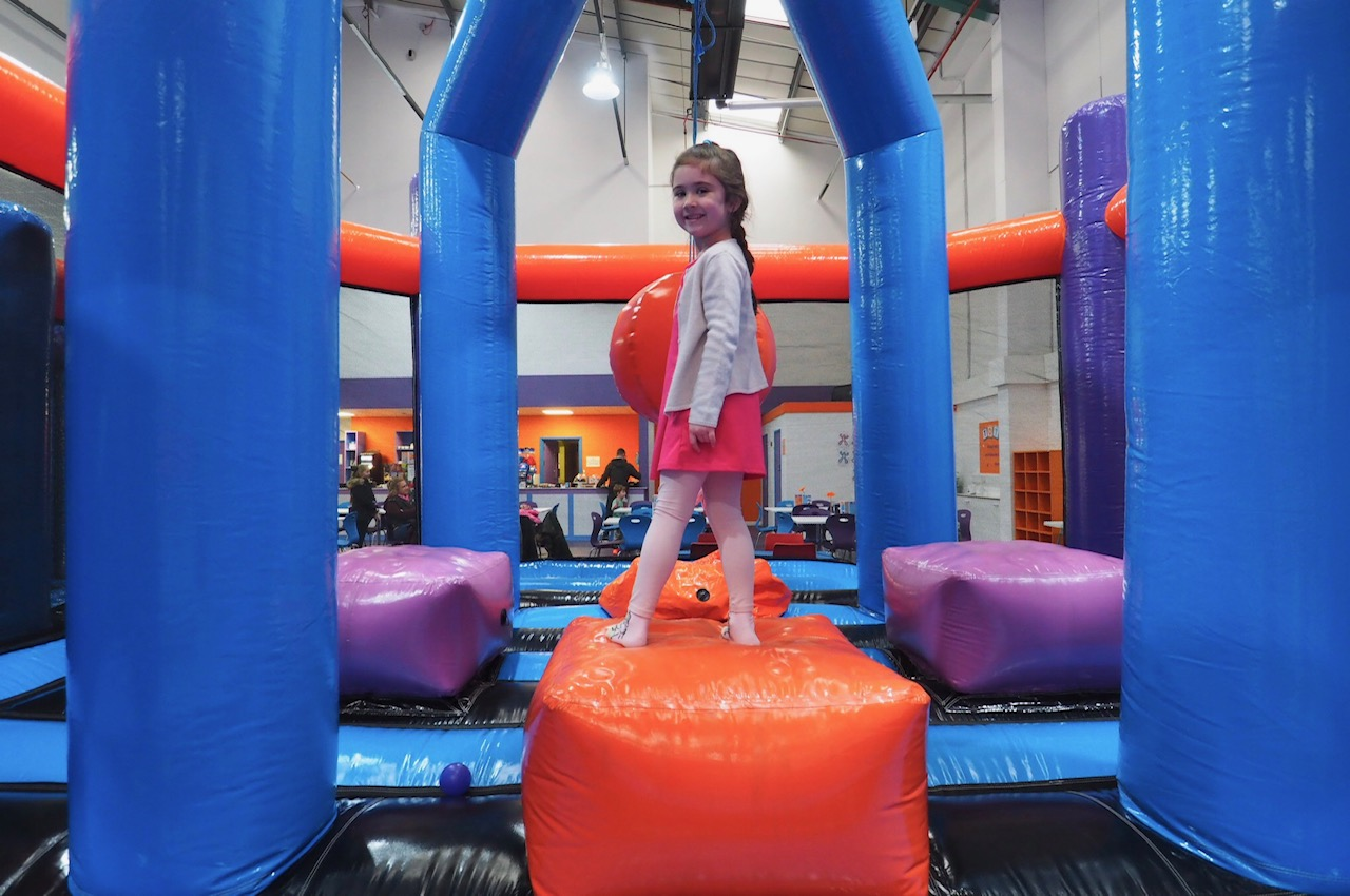 Young girl swinging ball Inflatanation Birmingham