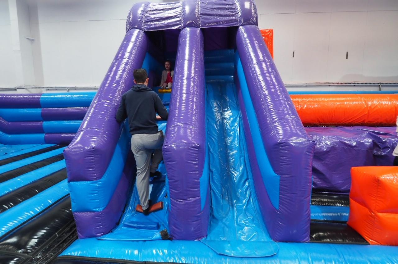 Dad taking daughter up slide at Inflatanation Birmingham