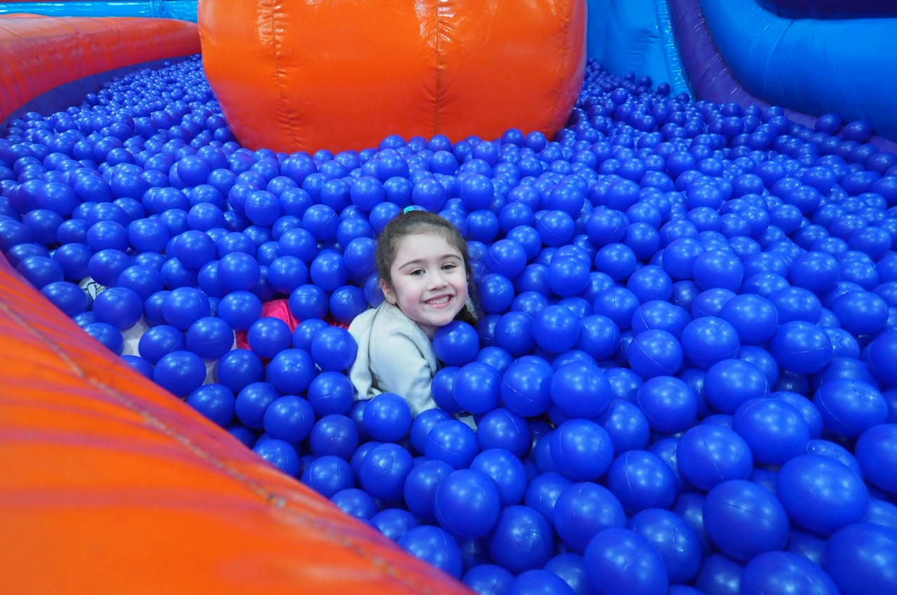 Girl in ball pit Inflatanation Birmingham