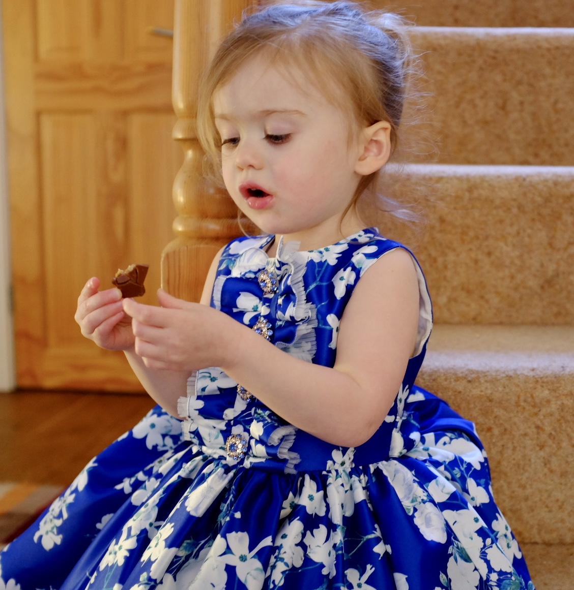 2 year old eating in David Charles spring/summer collection dress