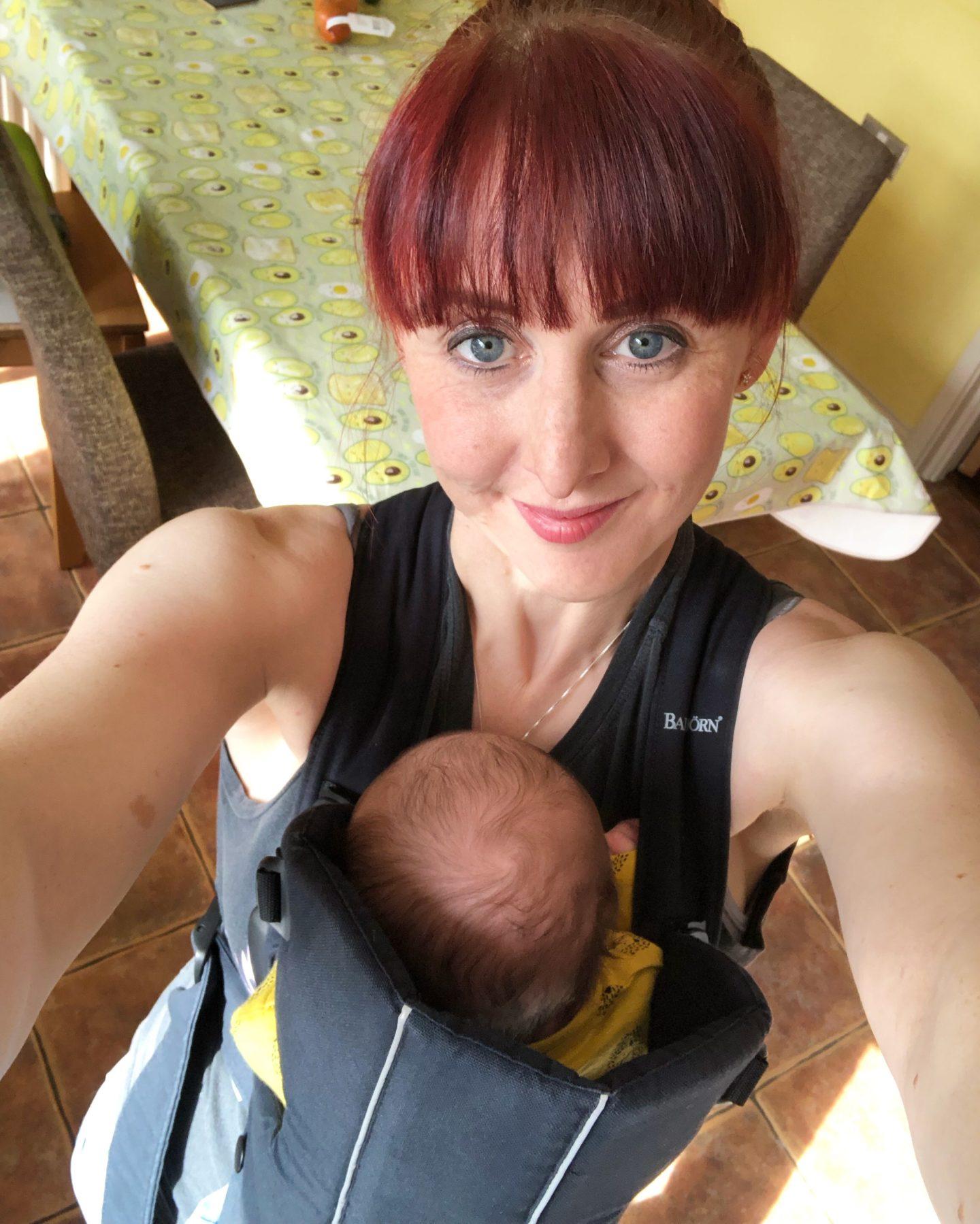 secrets about newborn babies - baby wearing mum