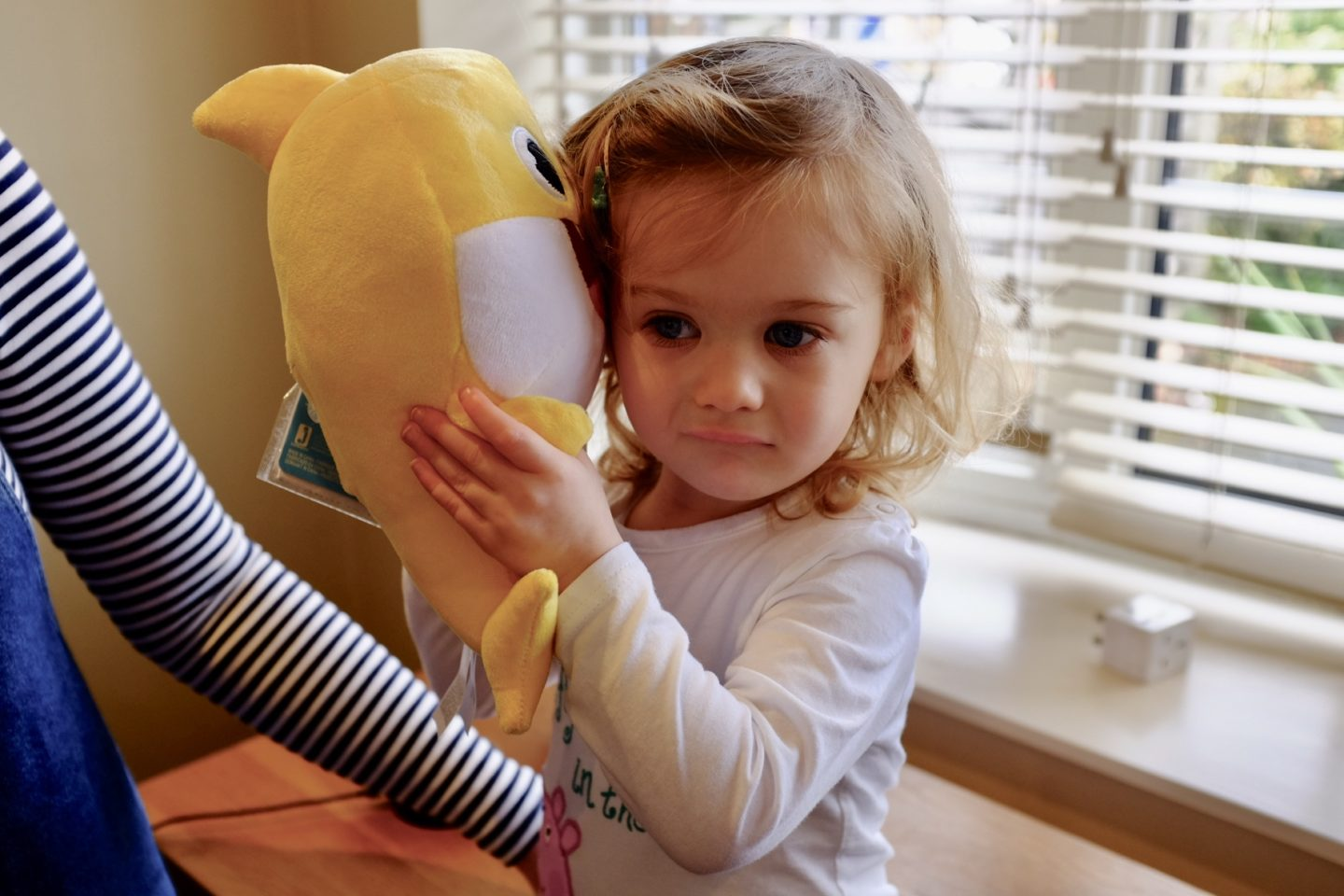 2 year old listening to the baby shark plush toy
