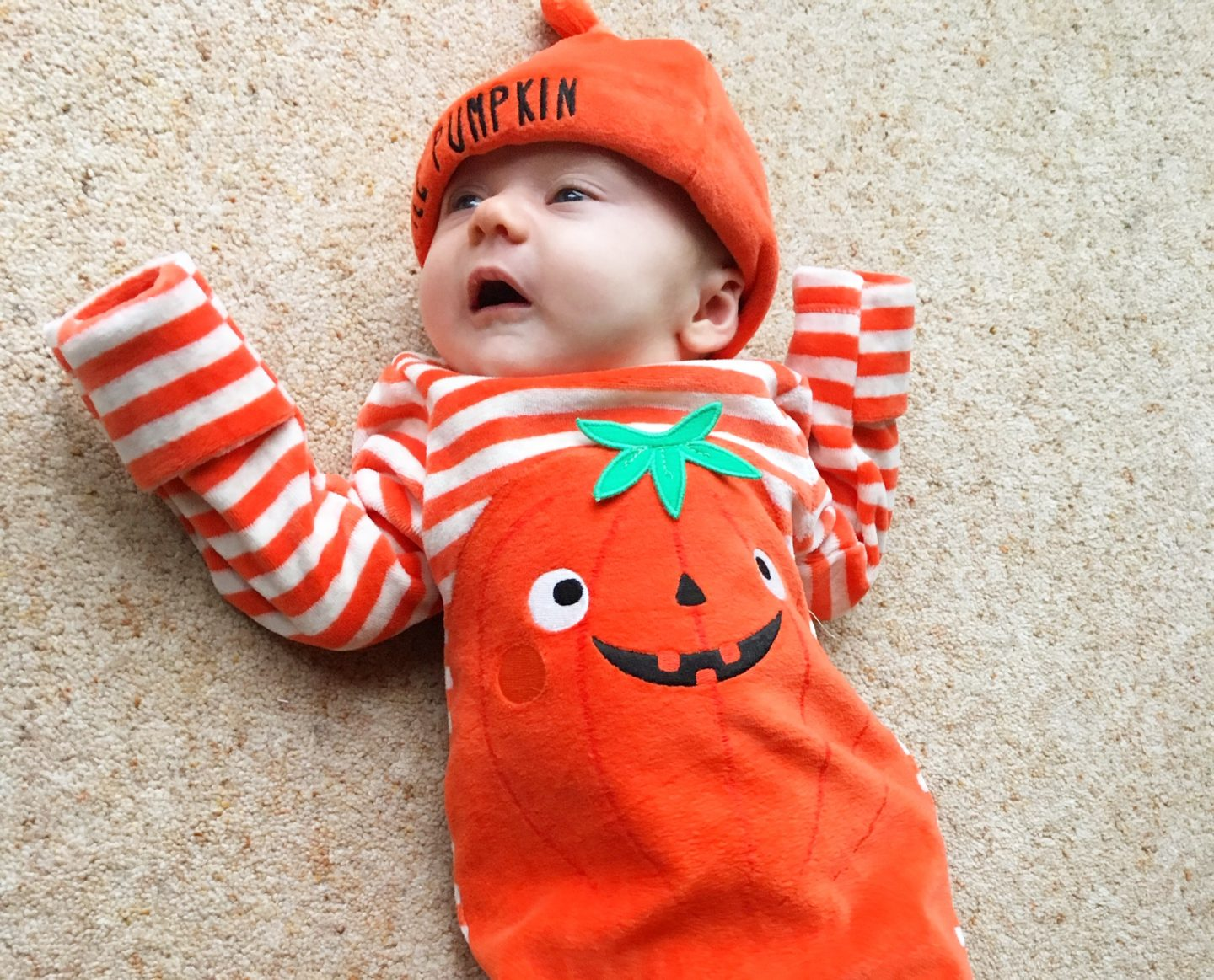 halloween at home baby dressed up as a pumpkin