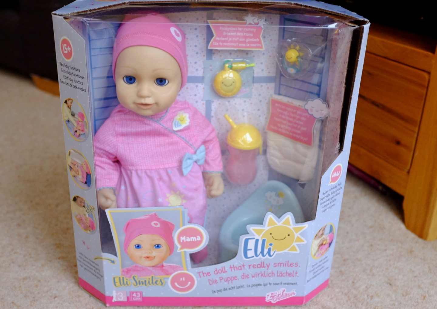 Elli Smiles doll in the box