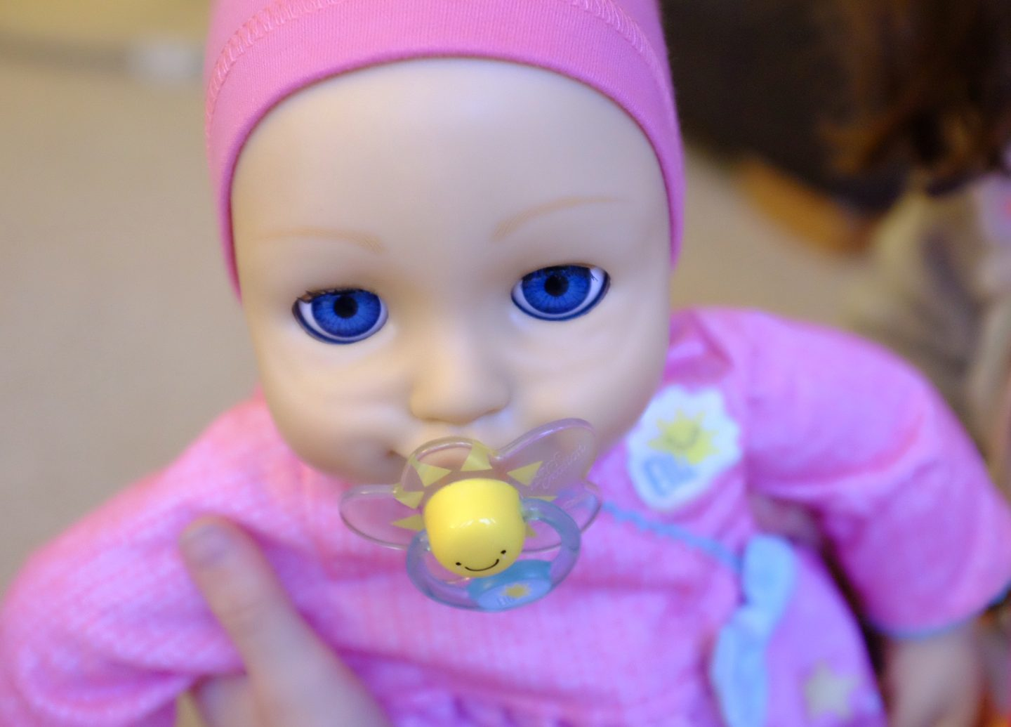 elli smiles doll with a dummy in