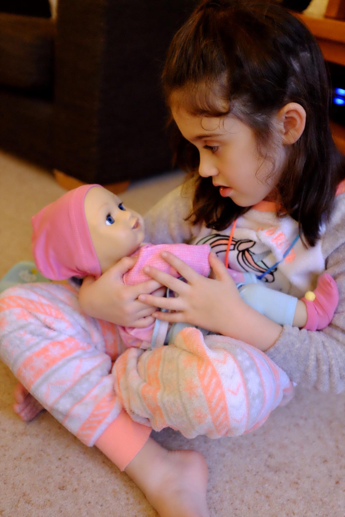 Elli Smiles doll cuddles