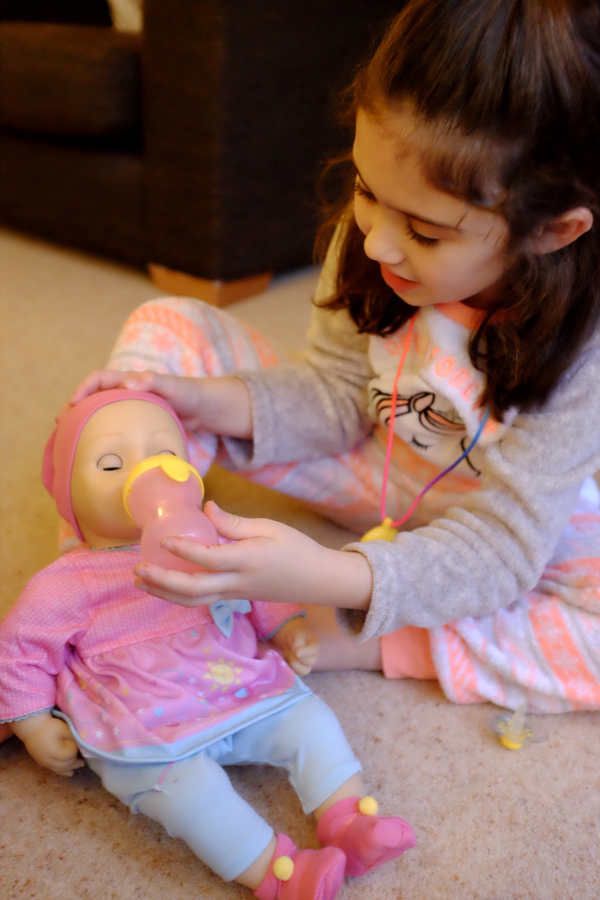 girl playing with elli smiles doll