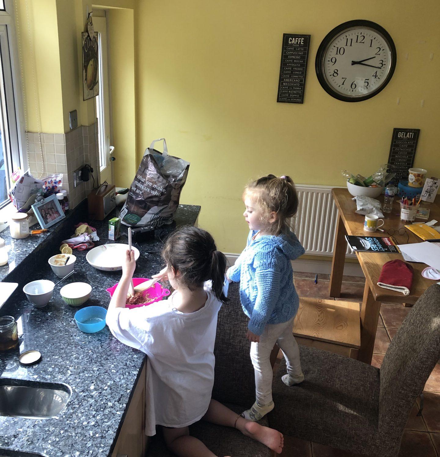 kids baking in a messy kitchen