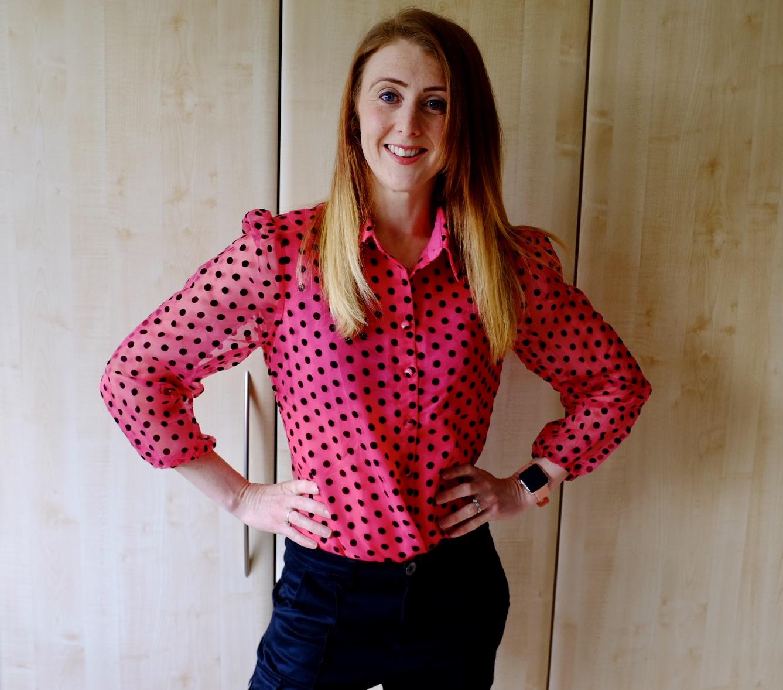 girl in polka dot red blouse