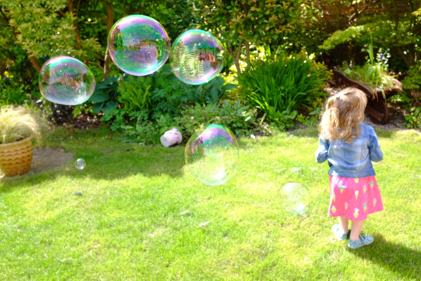 fun home activities - girl in the garden with bubbles