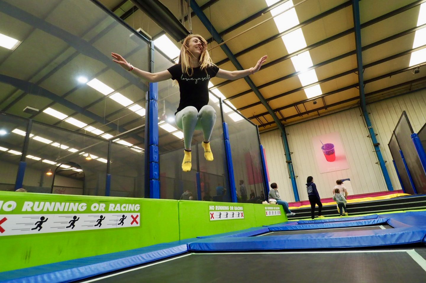 red head jumping high on trampoline