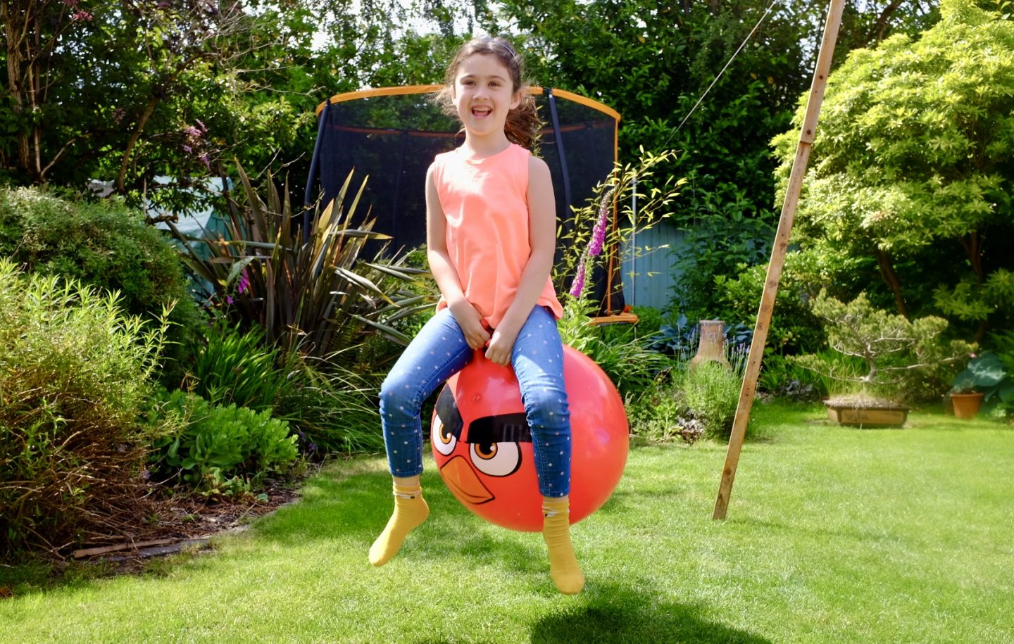 girl bouncing on the angry birds hopper