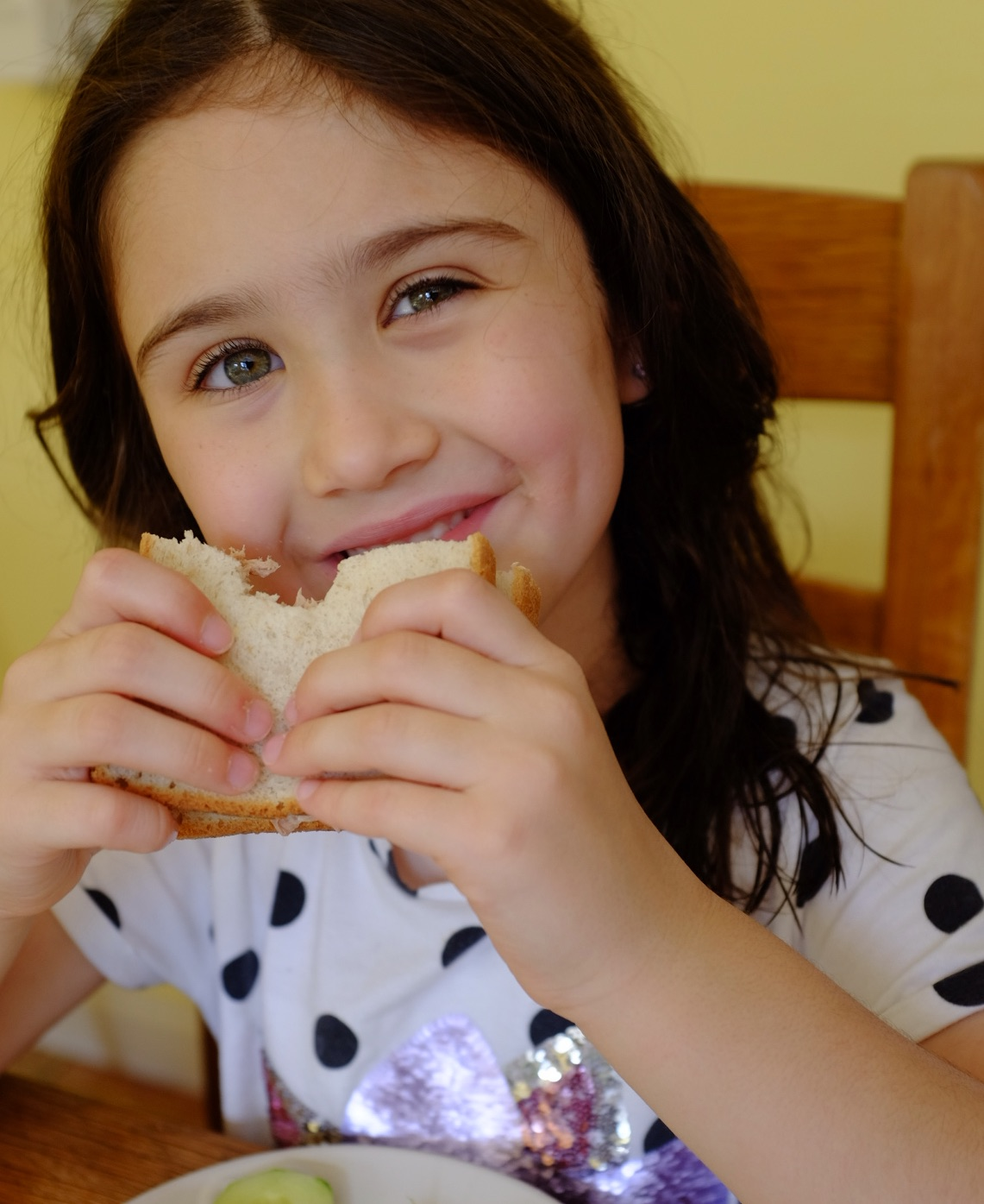 kids eat more healthily - girl eating a sandwich