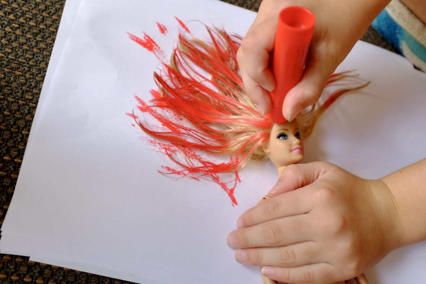 dye a barbie's hair red with paint sticks